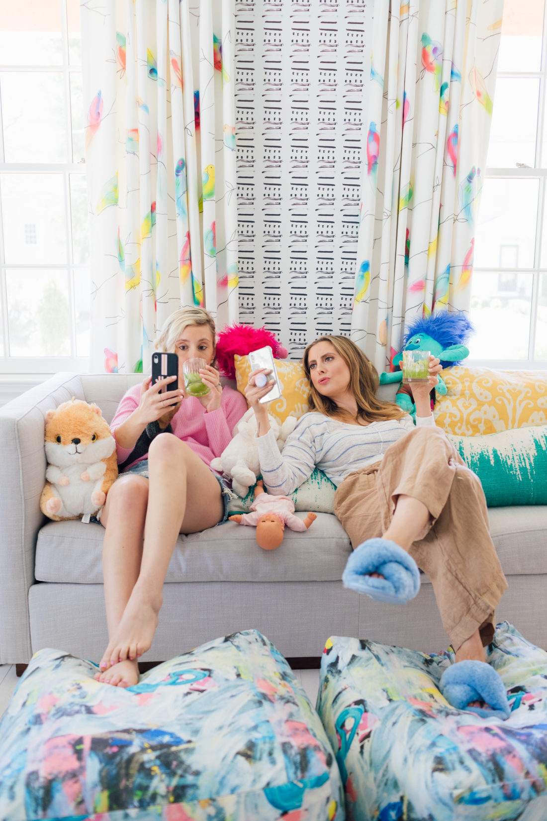 Eva Amurri Martino of Happily Eva After and Julia Dzafic of Lemon Stripes sit on a couch in the Martino house drinking Margaritas and reminiscing on their parenting style