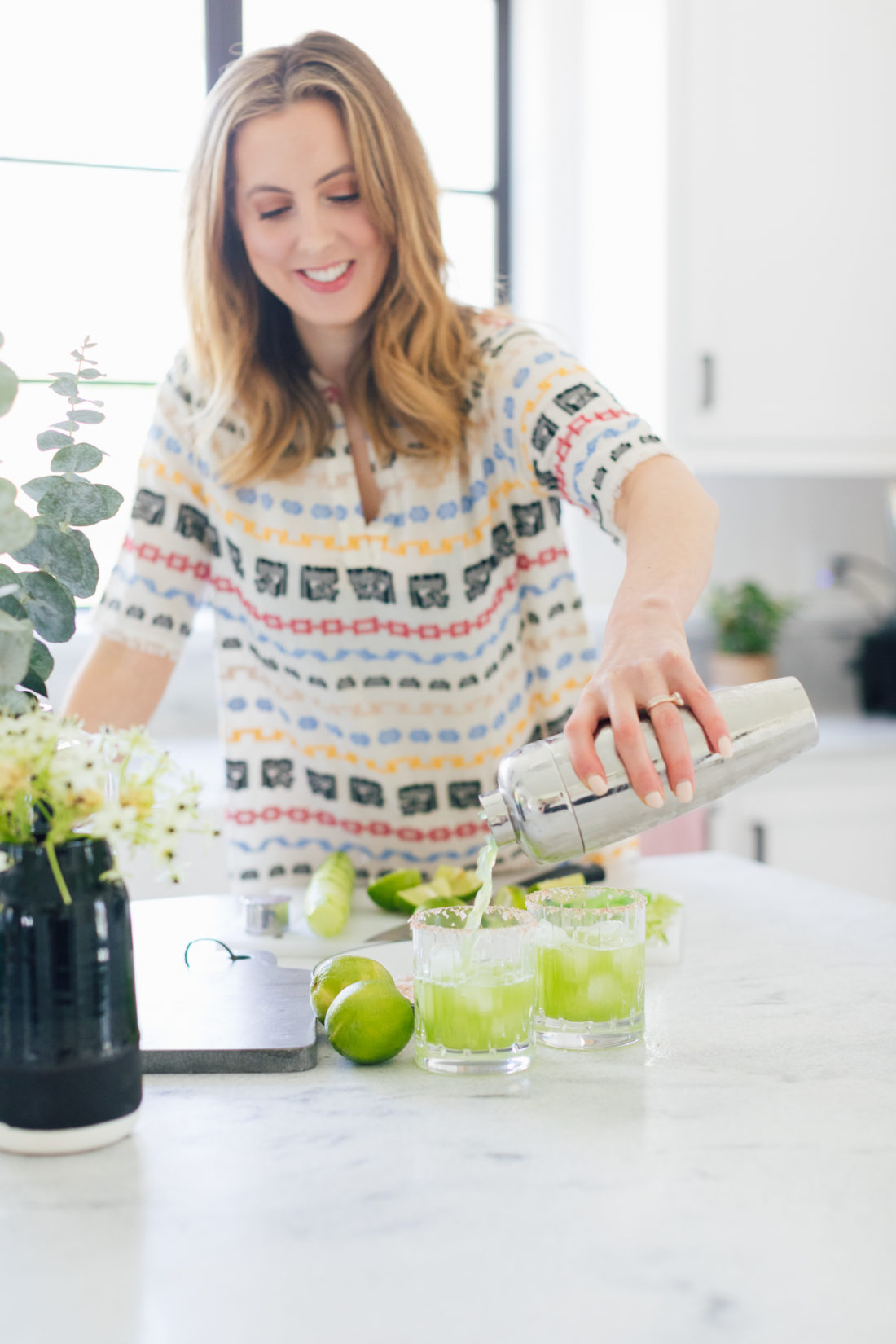 Eva Amurri Martino of Happily Eva After pours cucumber margaritas into a glass at her home in Connecticut