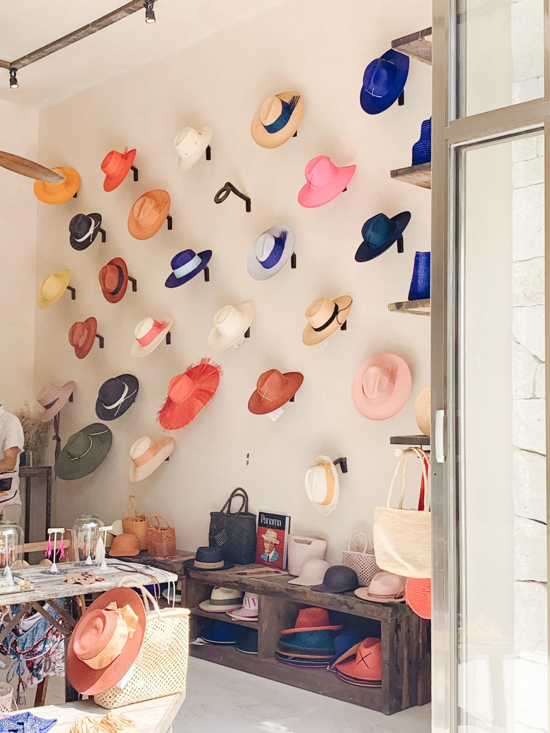 A Tulum boutique filled with colorful hats