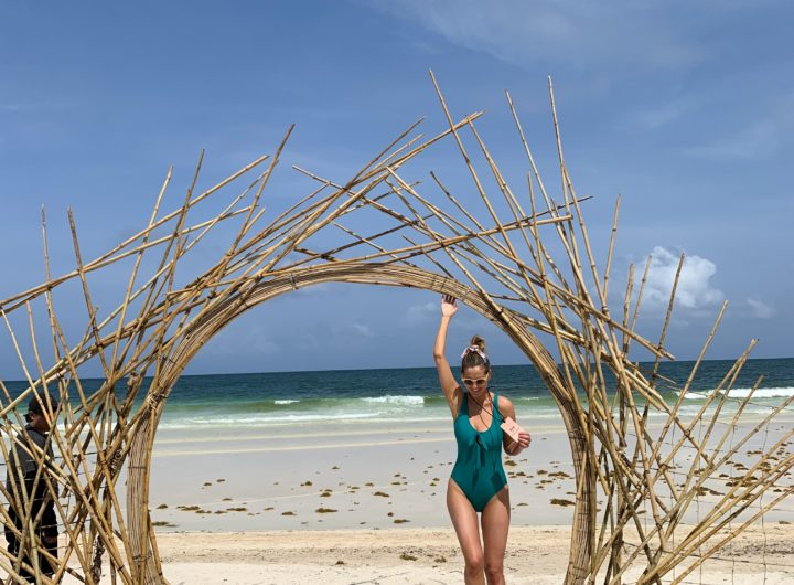 Eva Amurri Martino of Happily Eva After frolicking on a beach at Summit Tulum