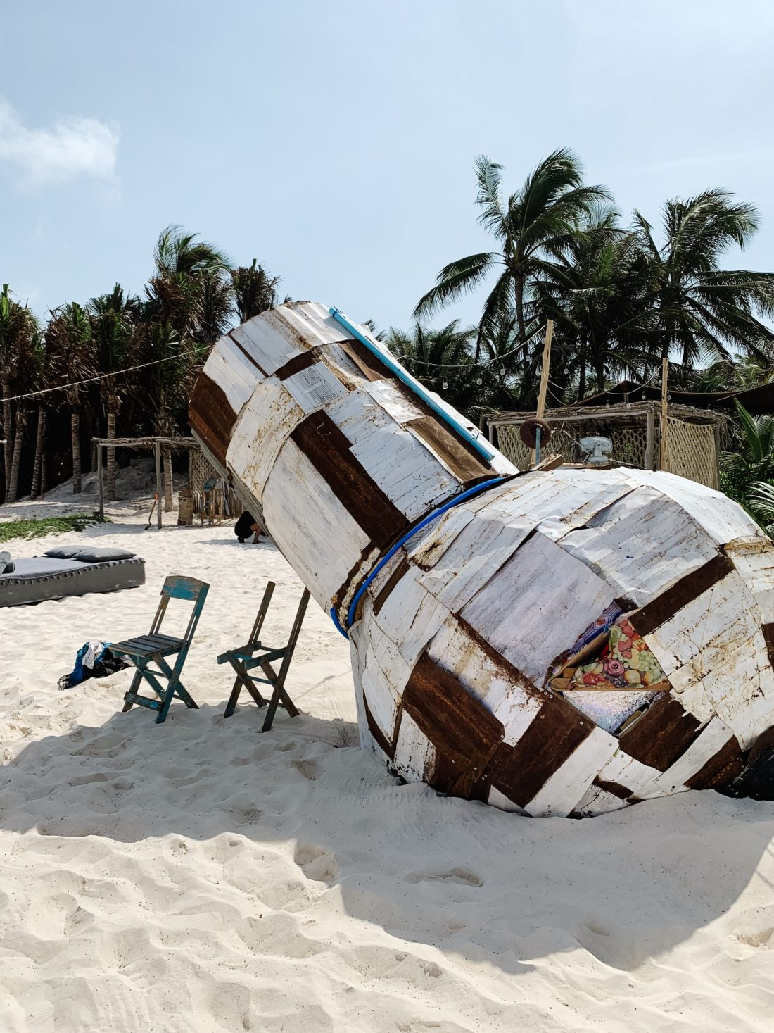 A wooden sculpture on the beach in Tulum Mexico