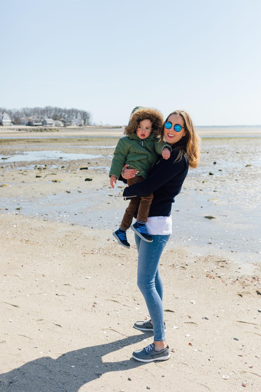 Eva Amurri Martino of Happily Eva After wears Sketchers GoWalk Lite Isla Boat Shoe with her son Major on the beach