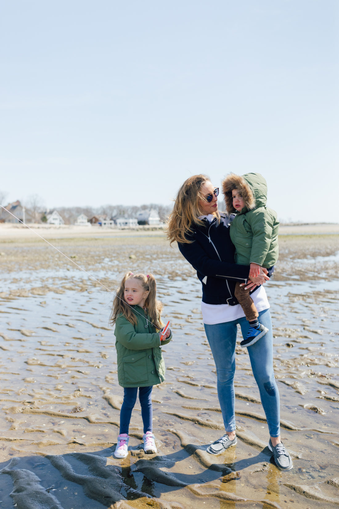Eva Amurri Martino of Happily Eva After wears Skechers GoWalk Lite Isla Boat Shoe with her kids Marlowe and Major on the beach