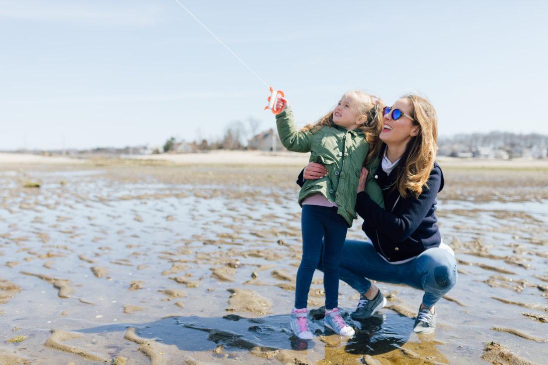 Eva Amurri Martino of Happily Eva After wears Sketchers GoWalk Lite Isla Boat Shoe with her daughter Marlowe on the beach
