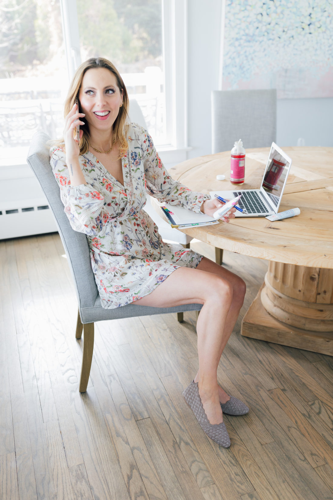Eva Amurri Martino of Happily Eva After sits at her computer wearing Skechers Cleo Scallop Ballet Flat