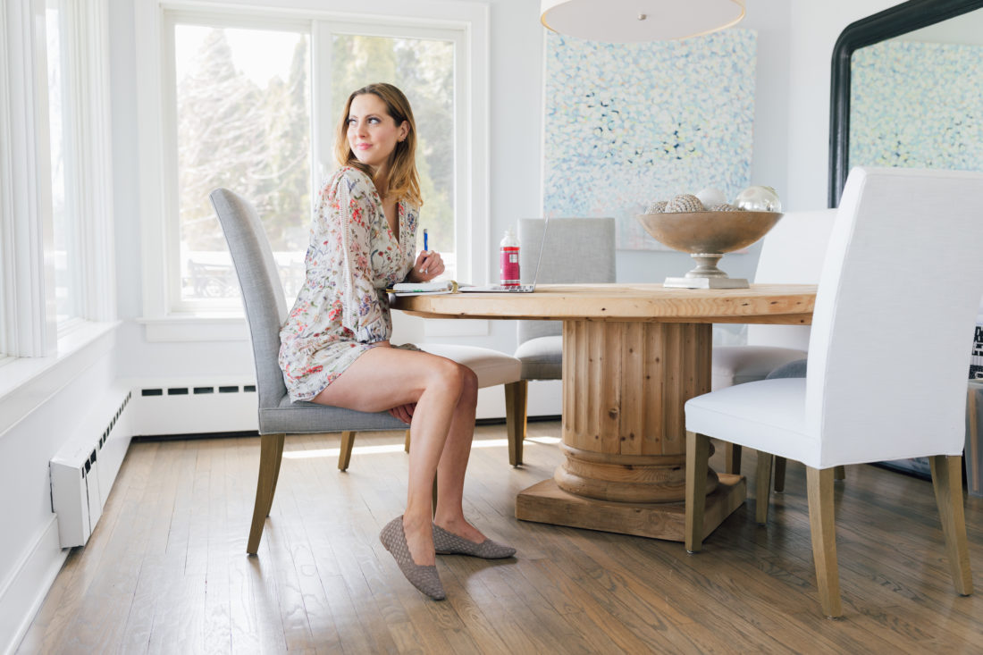 Eva Amurri Martino of Happily Eva After sits at her computer wearing Sketchers Cleo Scallop Ballet Flat