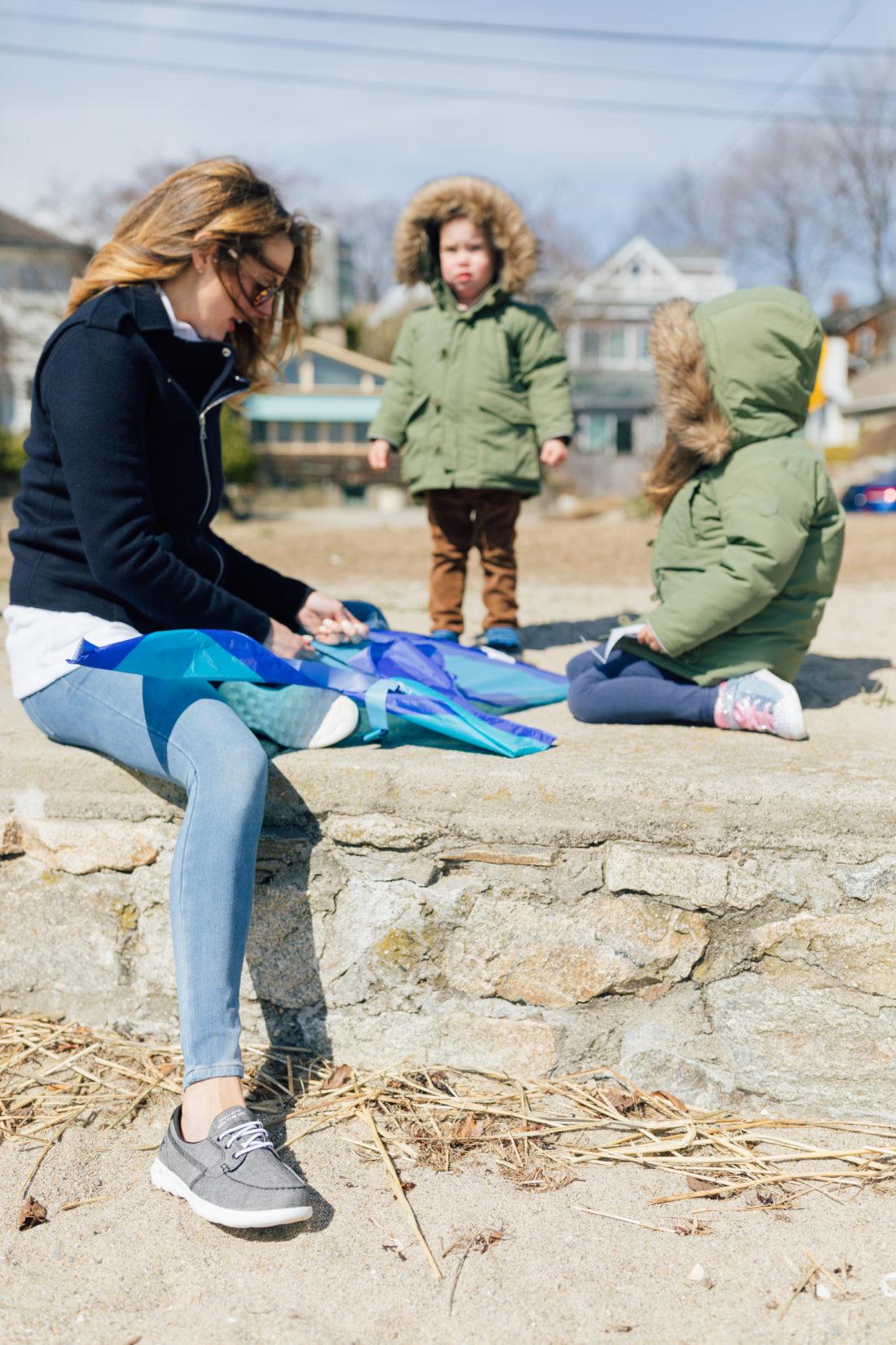 Eva Amurri Martino of Happily Eva After wears Sketchers GoWalk Lite Isla Boat Shoe with her kids Marlowe and Major on the beach