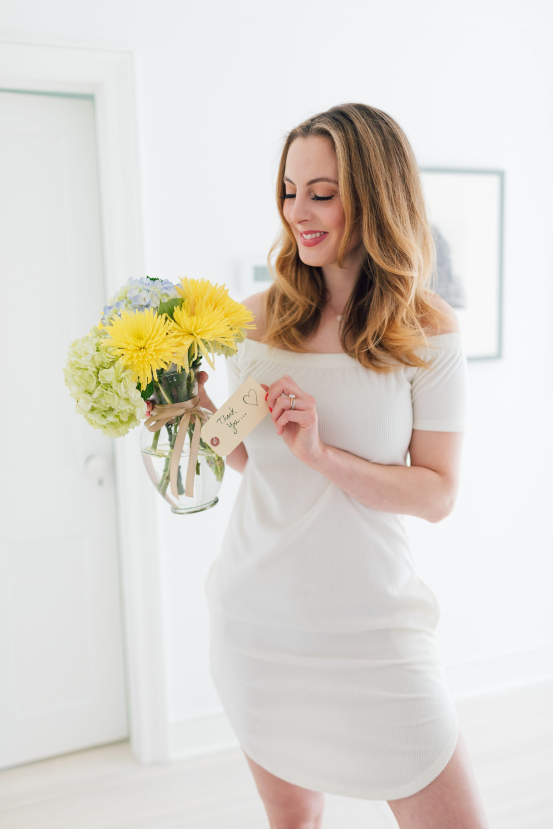 Eva Amurri Martino holds a bouquet of flowers as a gift for teachers