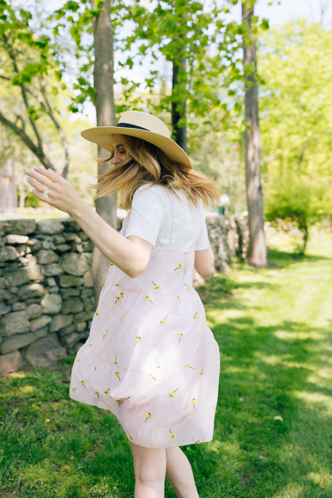 Eva Amurri Martino of Happily Eva After twirls around in a dress and sunhat