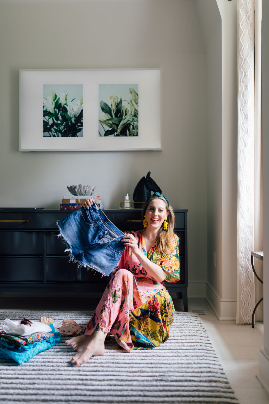 Eva Amurri Martino of Happily Eva After sits in her living room in Connecticut with her packing list for Tulum