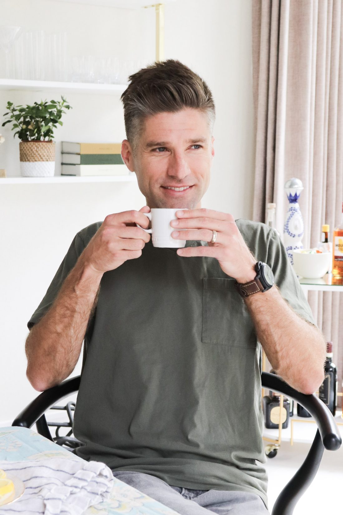 Eva Amurri Martino's husband Kyle reaching for a Le Cruesset mug