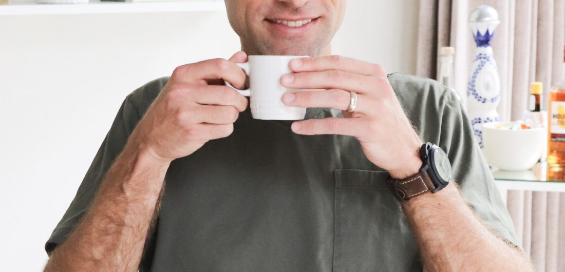 Eva Amurri Martino's husband Kyle reaching for a Le Cruesset mug