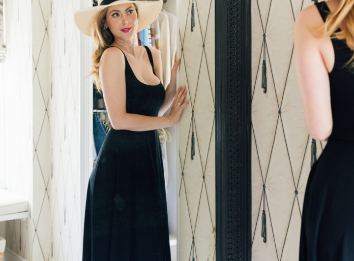 Eva Amurri Martino wears a hat while looking in the mirror