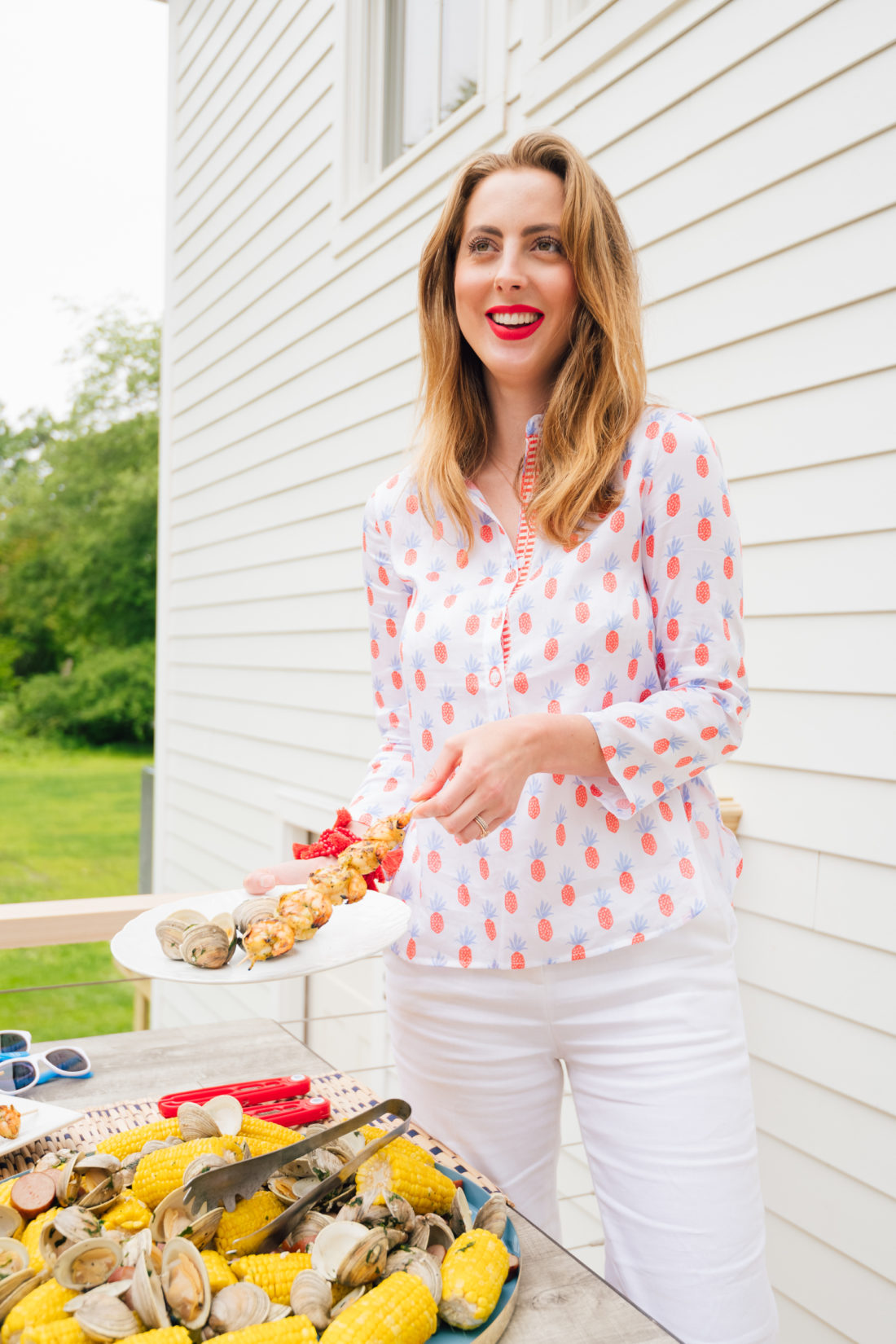 Eva Amurri Martino helps herself to some of the delicious food at her summer clambake