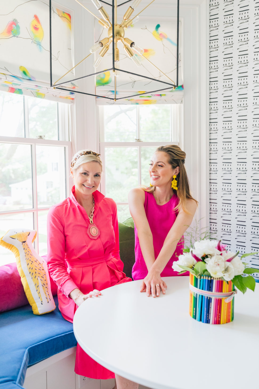 Eva Amurri Martino sits on a banquet with her interior designer Prudence Bailey from Prudence Home & Design