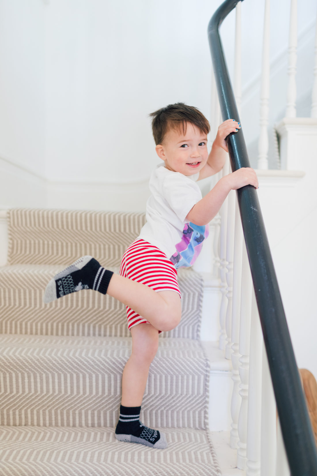Major Martino stands on the stairs wearing his new big boy underwear as he starts the potty training process