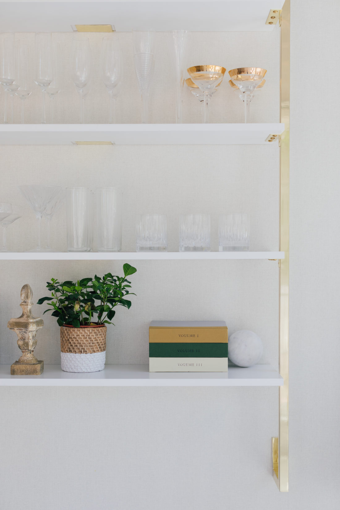 Wall shelves with entertaining pieces