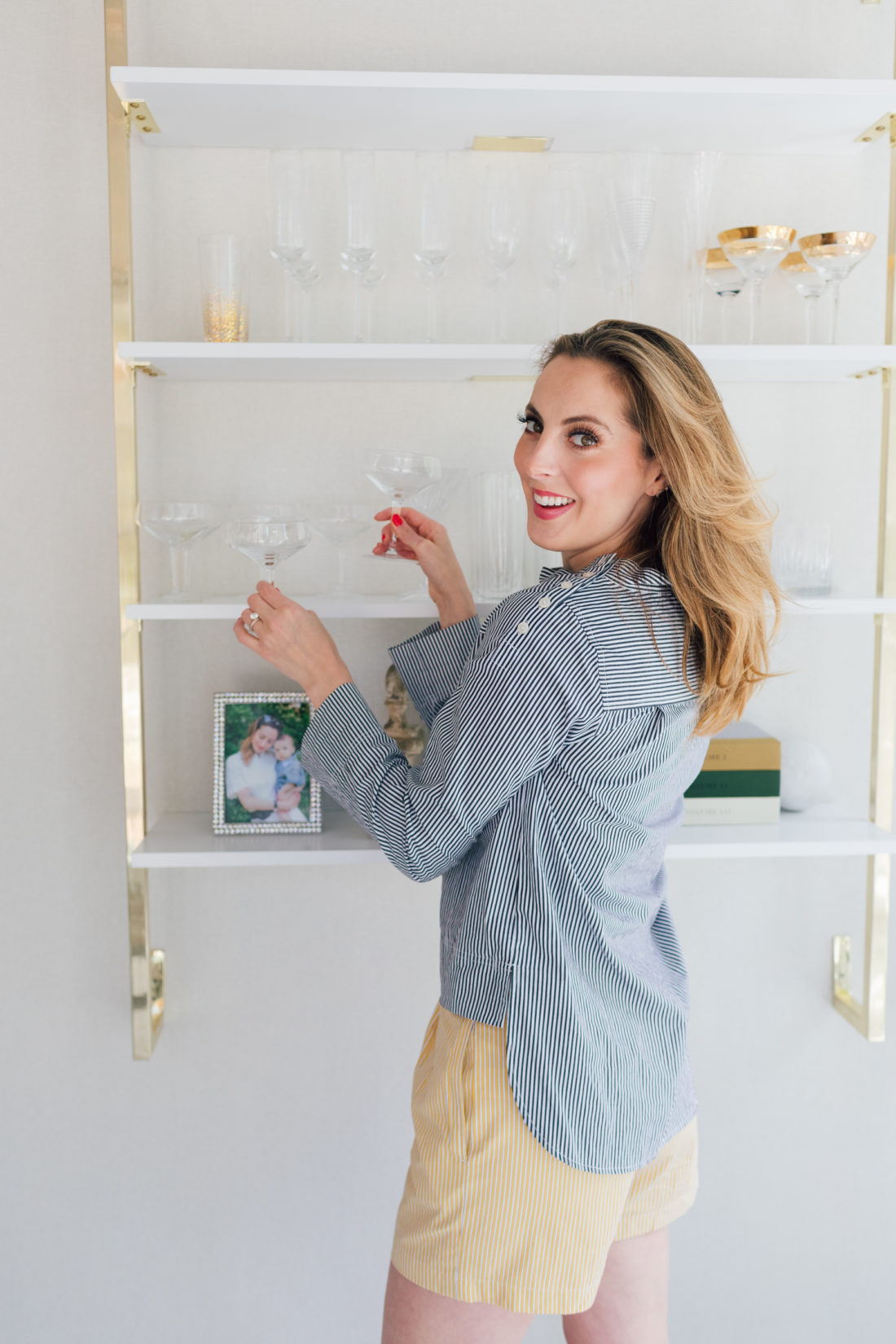 Eva Amurri Martino stands next to shelving in her dining room