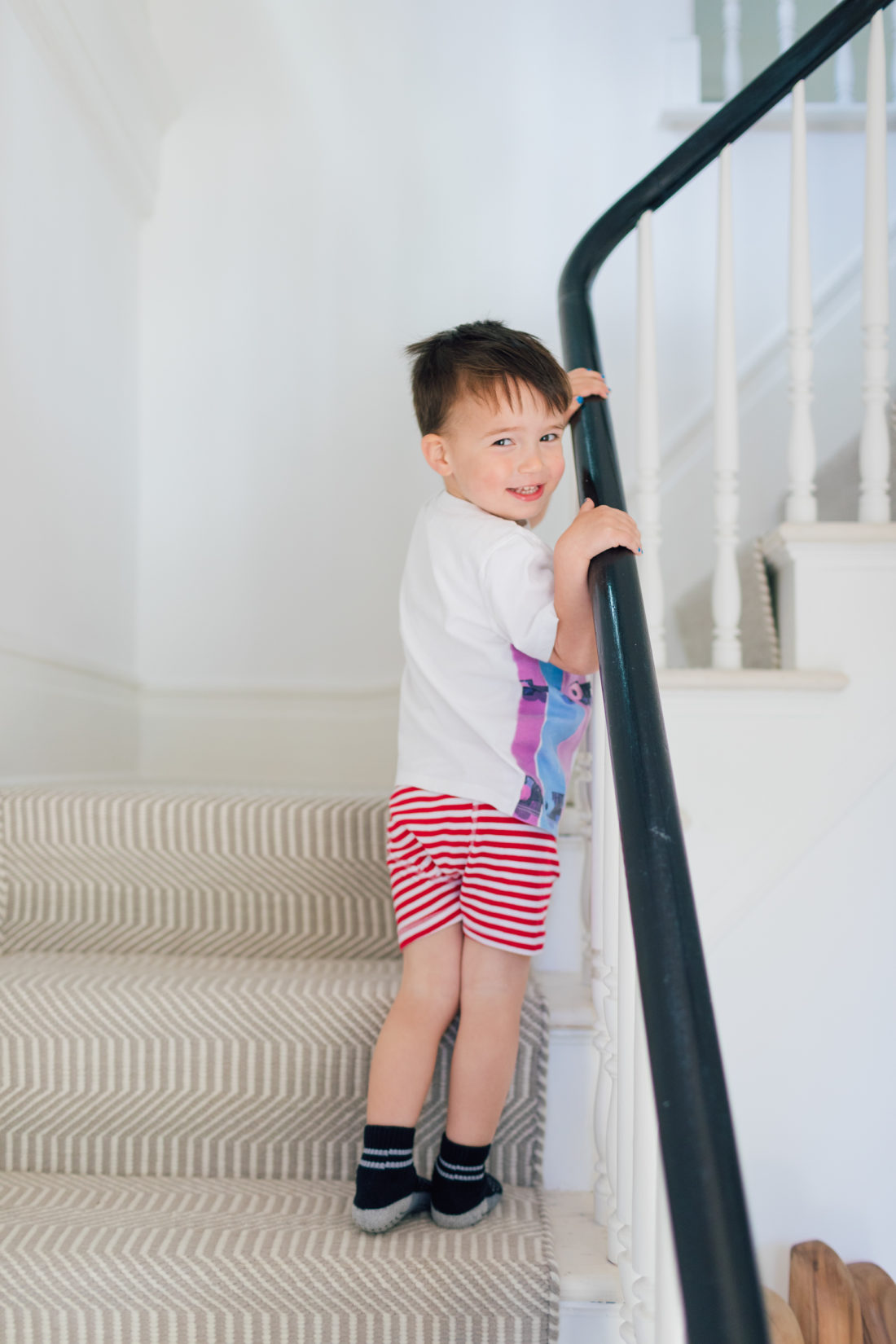 Major Martino turns to walk up the staircase in his connecticut home, wearing the big boy underwear he received at the start of potty training