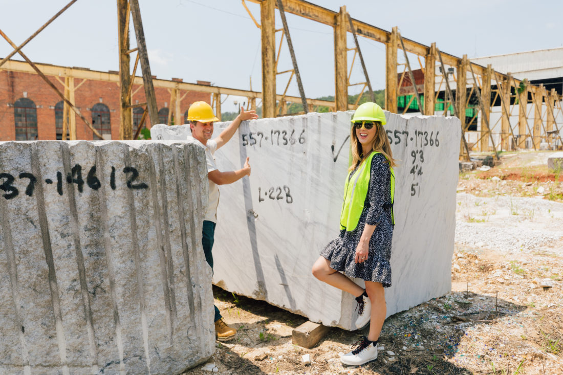 Eva Amurri Martino stands in front of a giant slab of marble at the Polycor quarry in Georgia