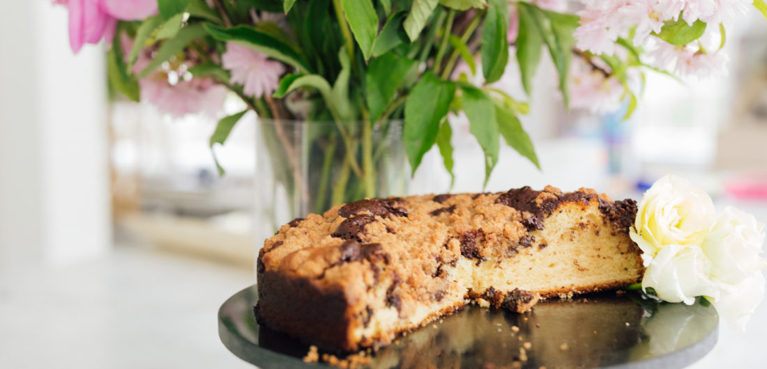 Eva Amurri Martino's coffee cake next to a vase of gorgeous flowers