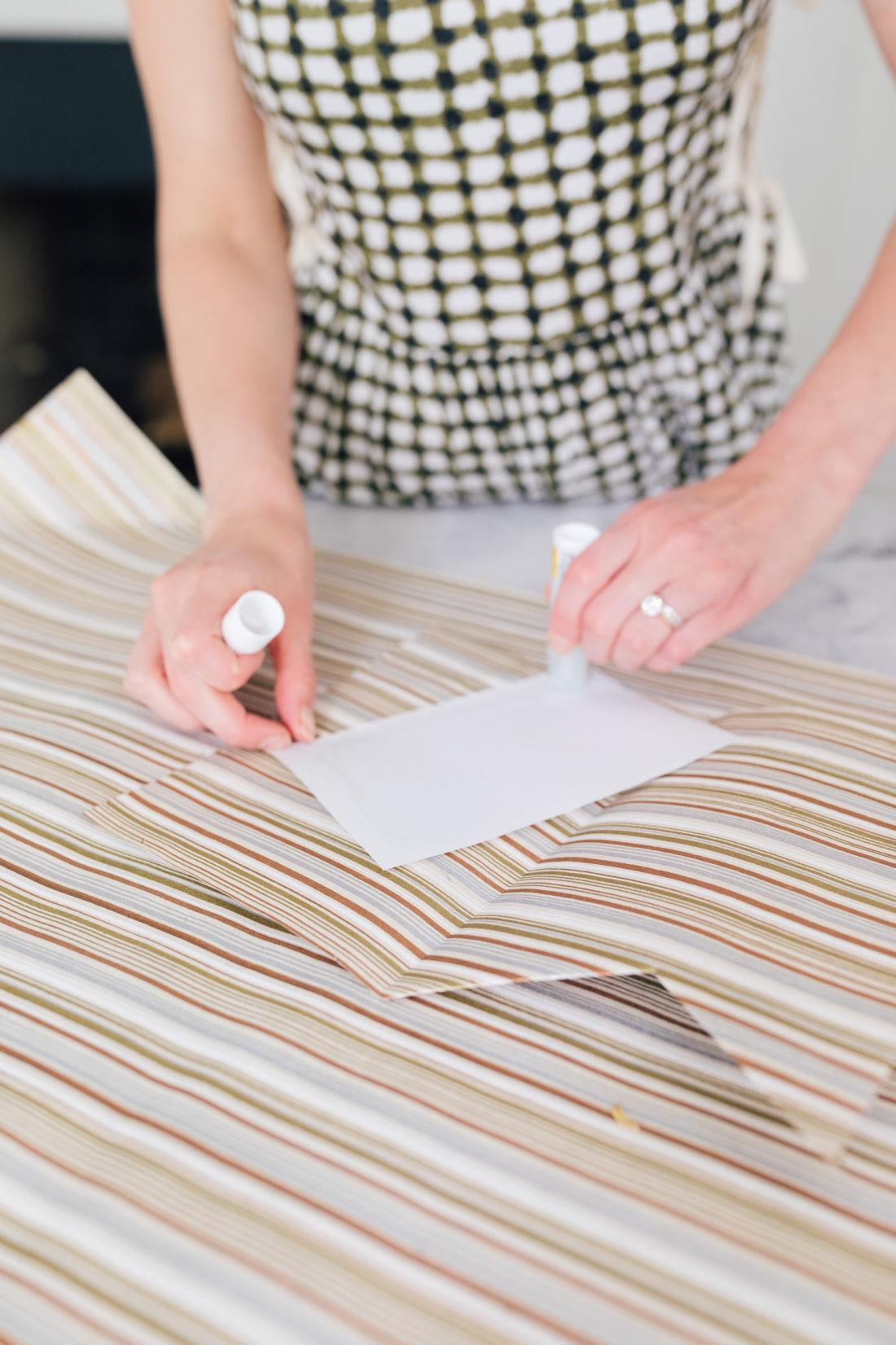 Eva Amurri Martino uses a glue stick to adhere her DIY shirt and tie card