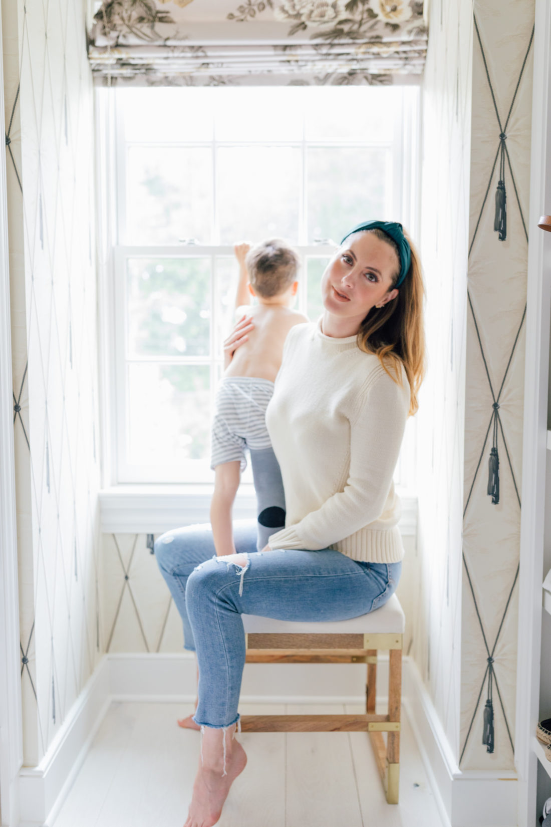 Eva Amurri Martino in bronzed glowy makeup holding son Major