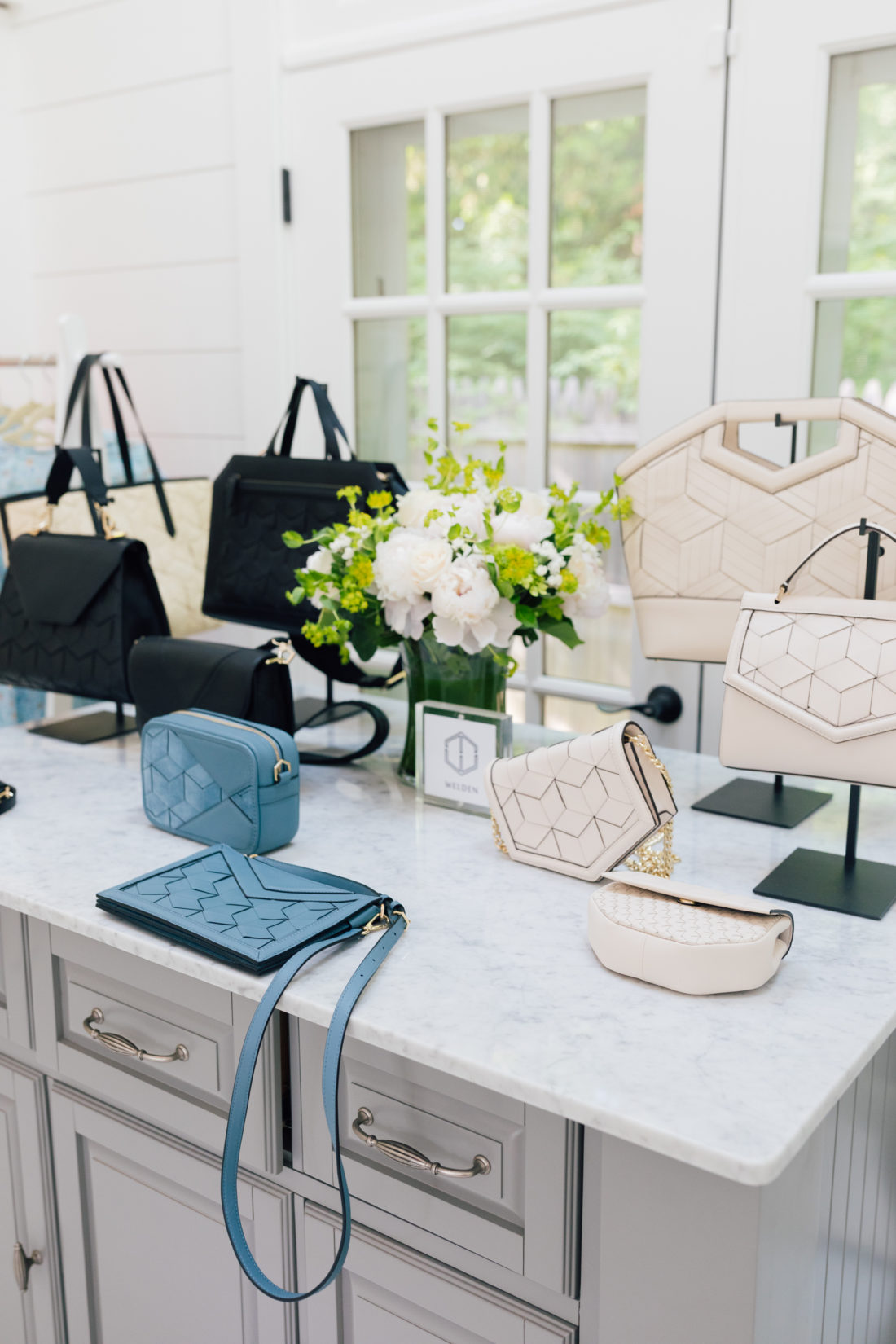 A selection of Welden bags sits atop a table in the Happily Eva After studio
