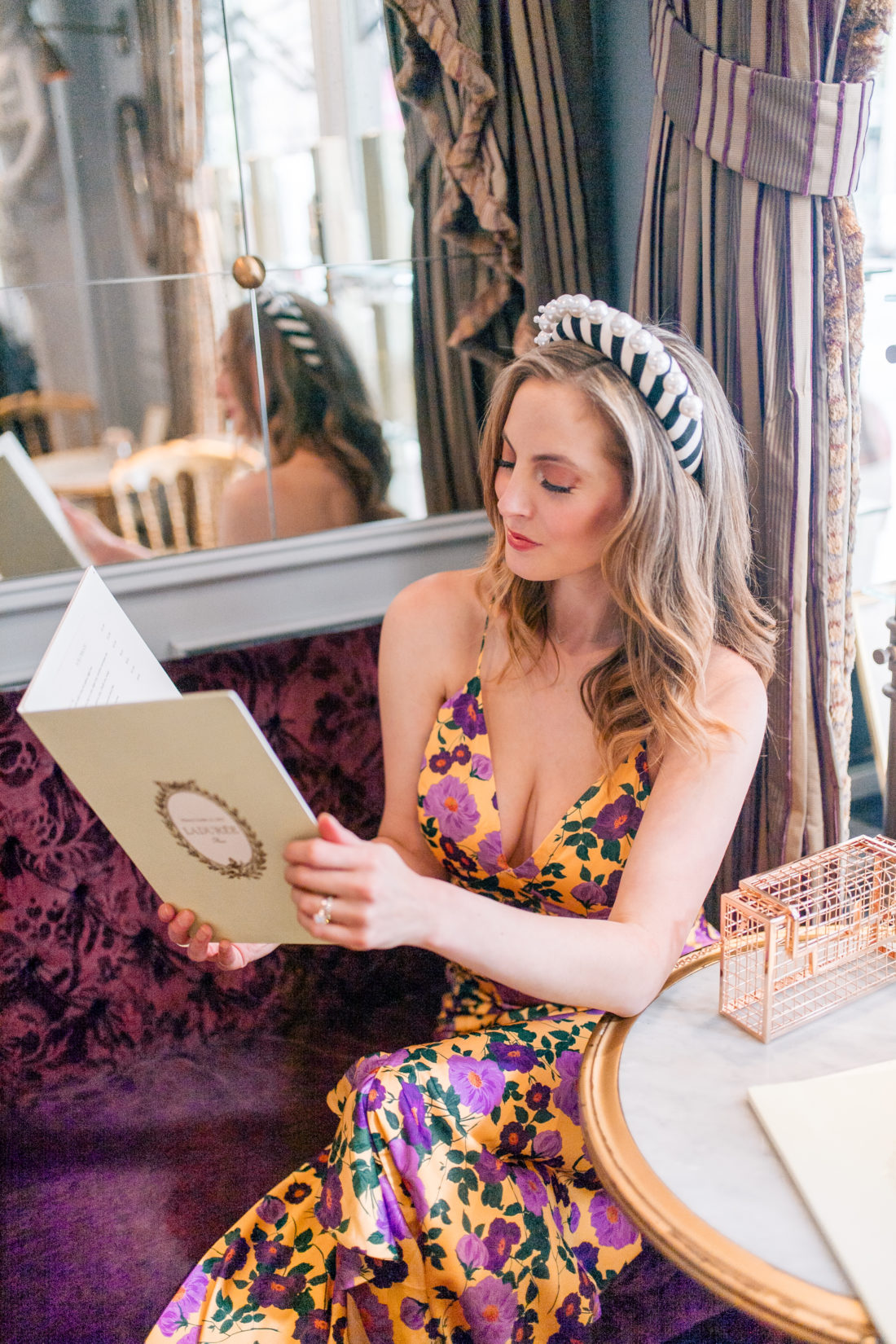 Eva Amurri Martino reads the menu at Ladurée on the Upper East Side