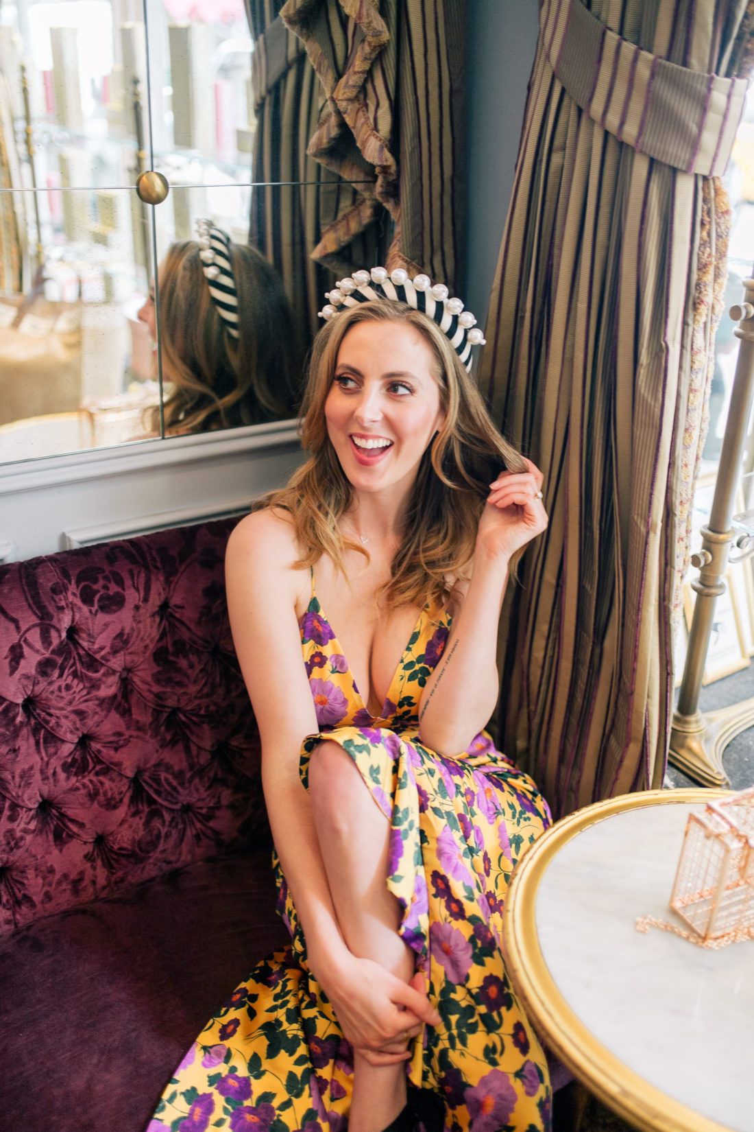 Eva Amurri Martino wears a bright flowery dress and a statement headband at Ladurée on the Upper East Side
