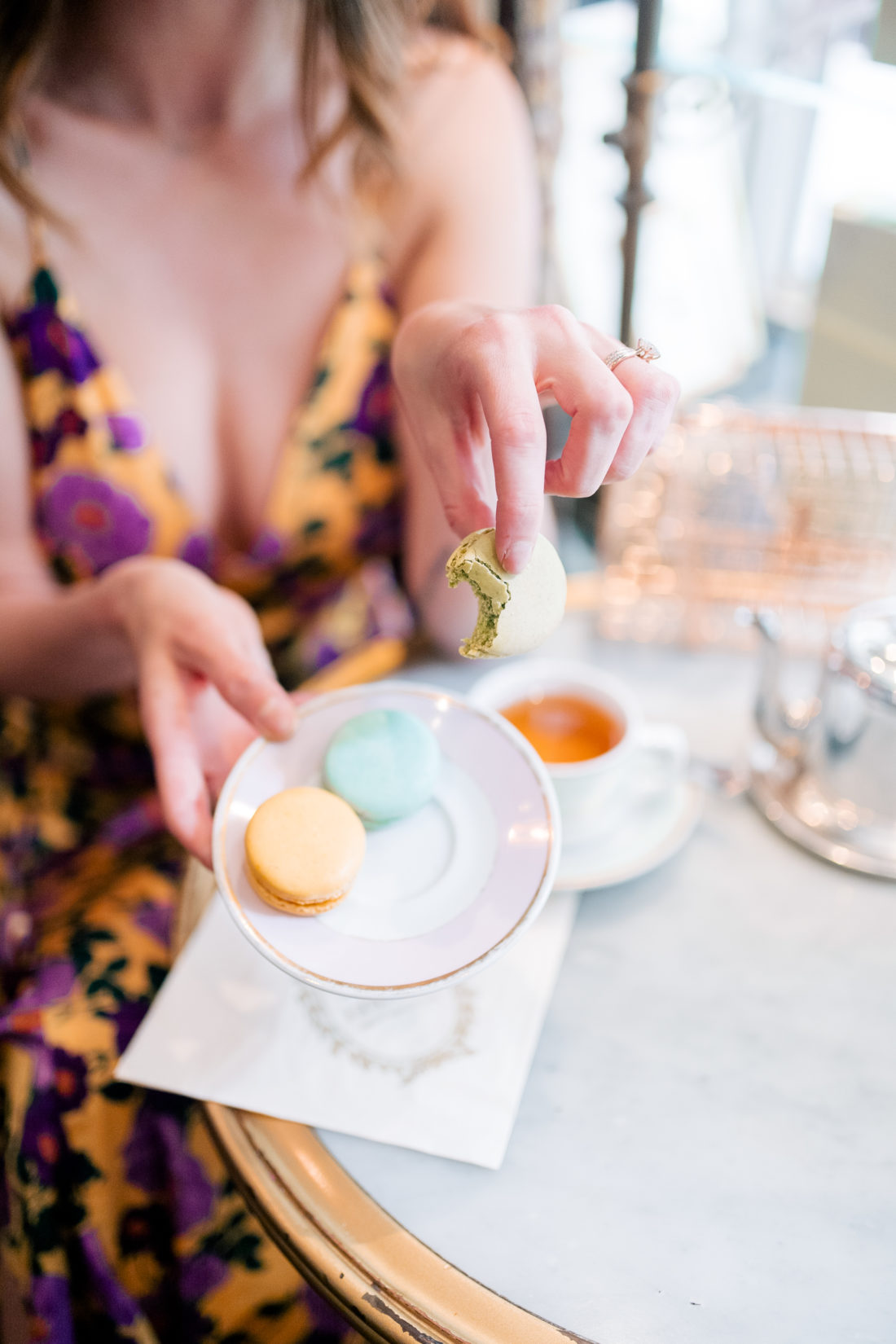 Eva Amurri Martino holds a plate of instagramable food in NYC from Ladurée