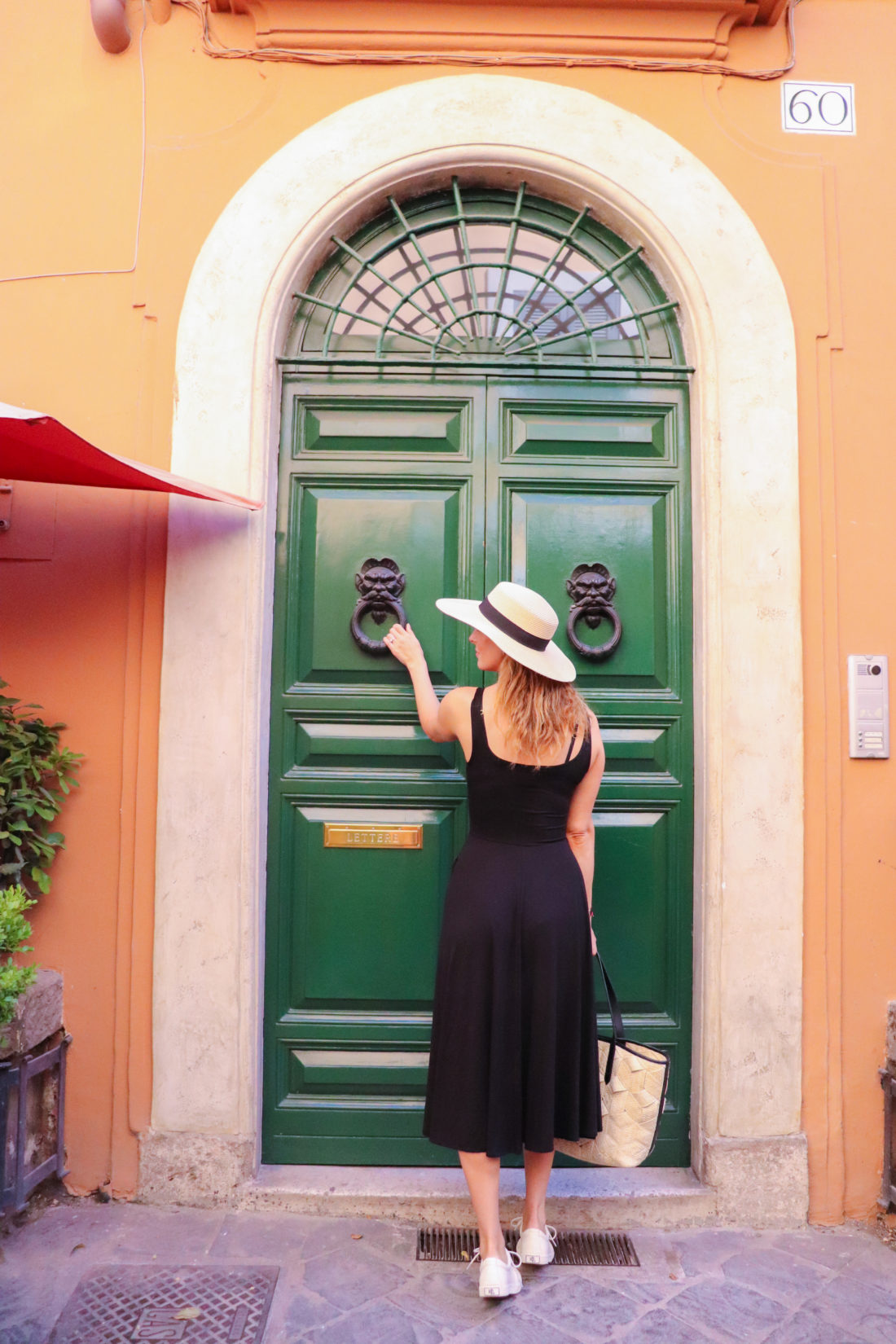 Eva Amurri Martino in front of a dramatic green door in Italy