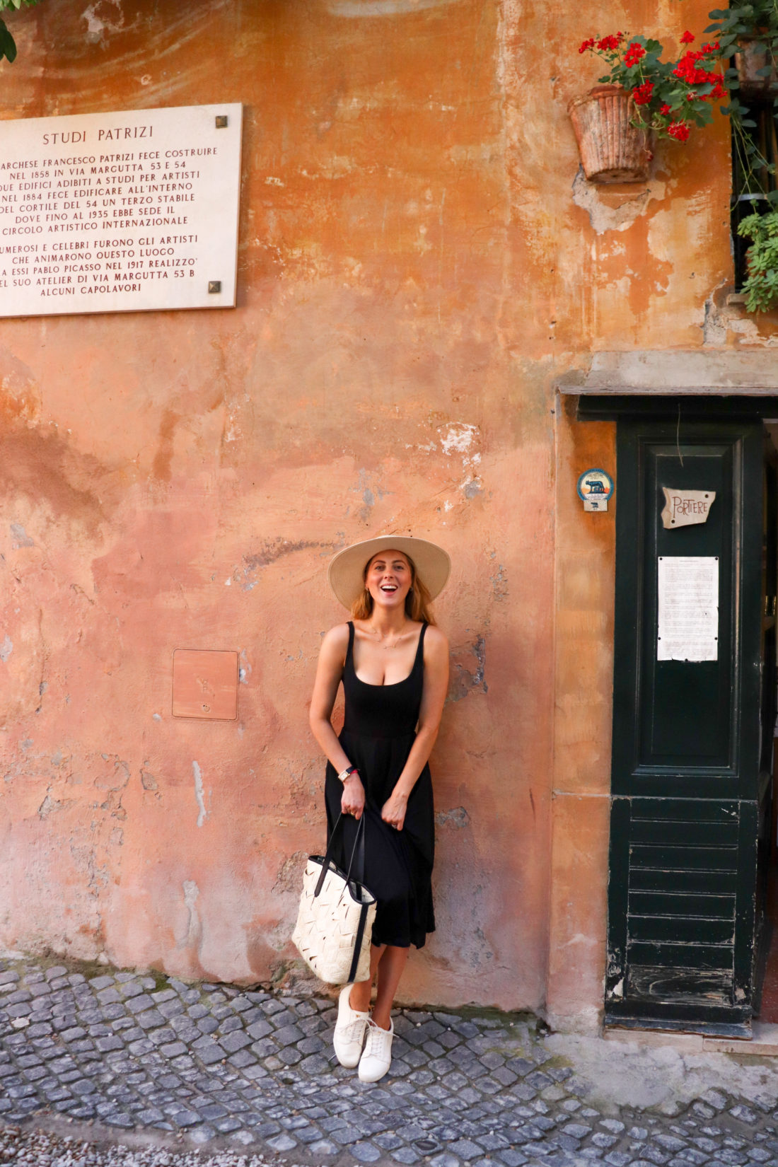 Eva Amurri Martino next to a pastel wall in Italy