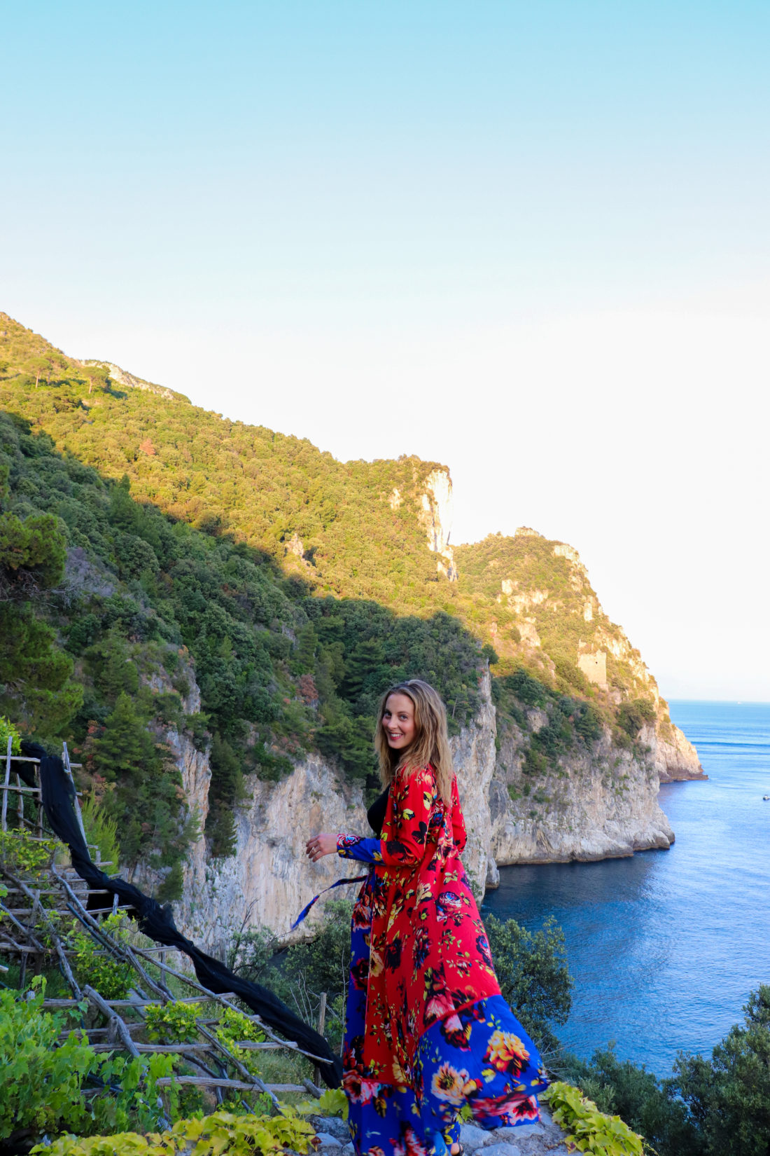 Eva Amurri Martino wears a colorful dress on the cliffs of Amalfi