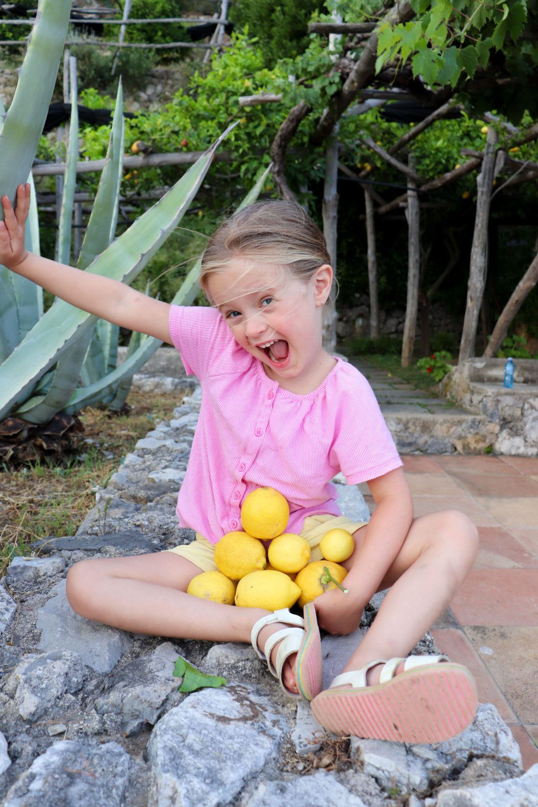 Eva Amurri Martino's daughter Marlowe collects lemons in Amalfi