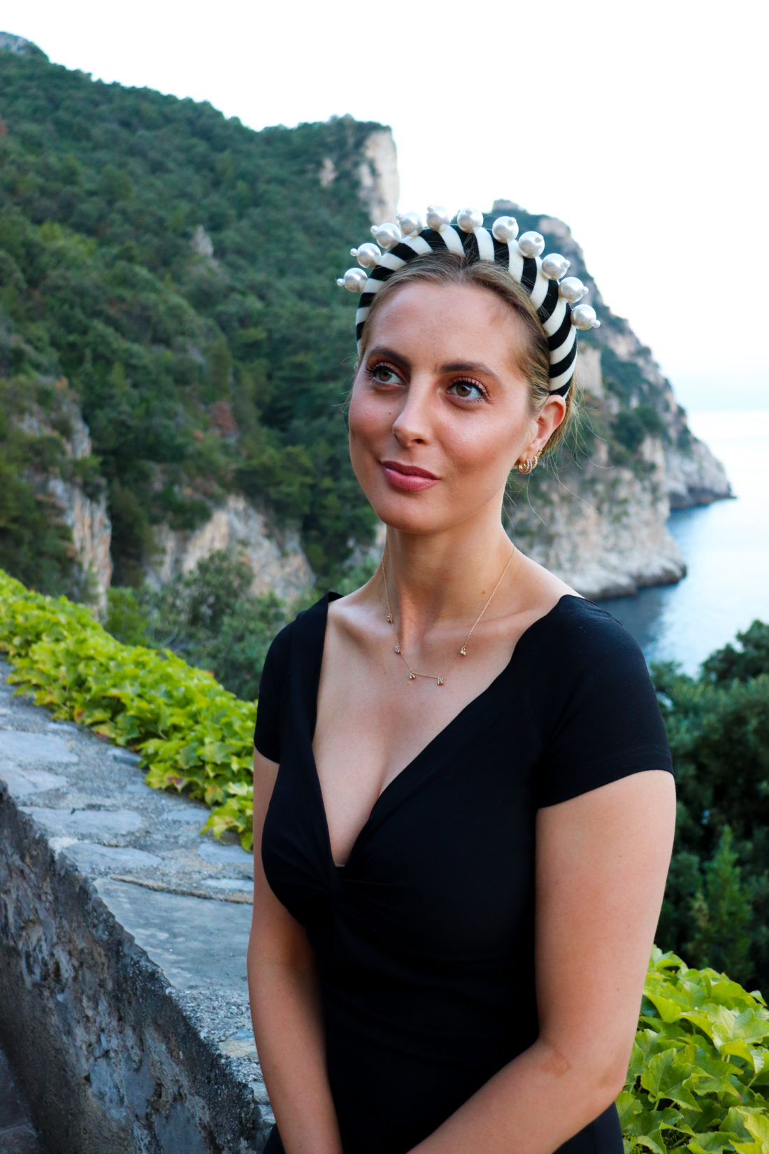 Eva Amurri Martino wears a pearl studded headband in the Amalfi Coast