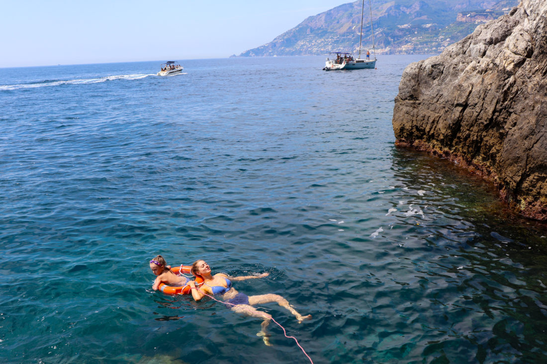 Eva Amurri Martino swims in the mediterranean sea with daughter Marlowe