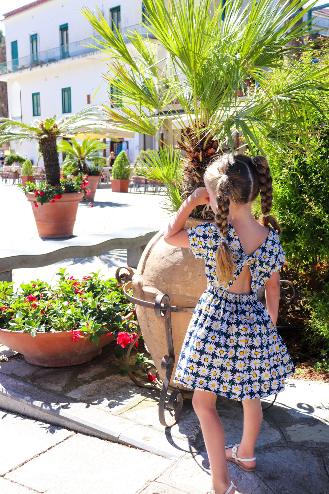 Eva Amurri Martino's daughter Marlowe wears a sunflower sundress in Italy