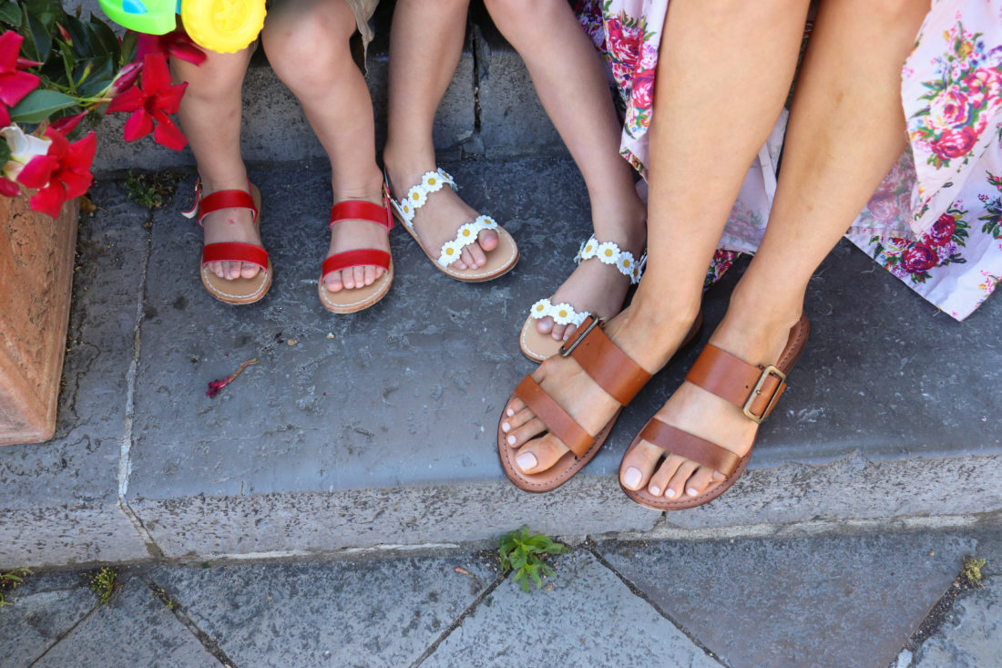 Eva Amurri Martino wears matching hand made leather sandals with her children in Amalfi