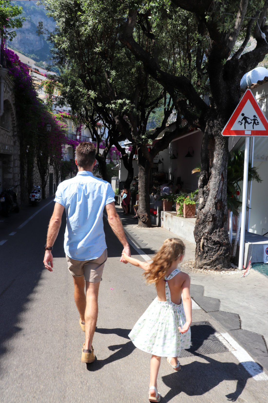 Kyle Martino holds daughter Marlowe's hand on the Amalfi Coast
