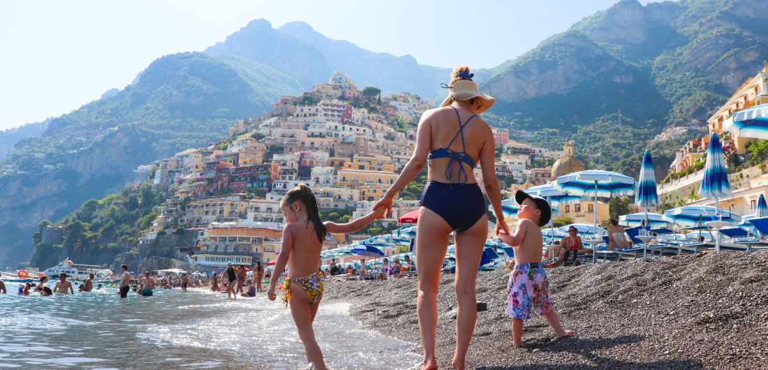 Eva Amurri Martino hangs on the beach in Amalfi with her children Marlowe and Major