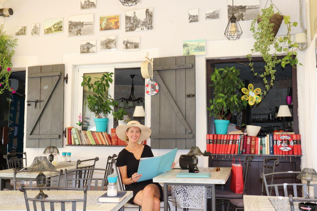 Eva Amurri Martino reads a menu at a cafe in Croatia