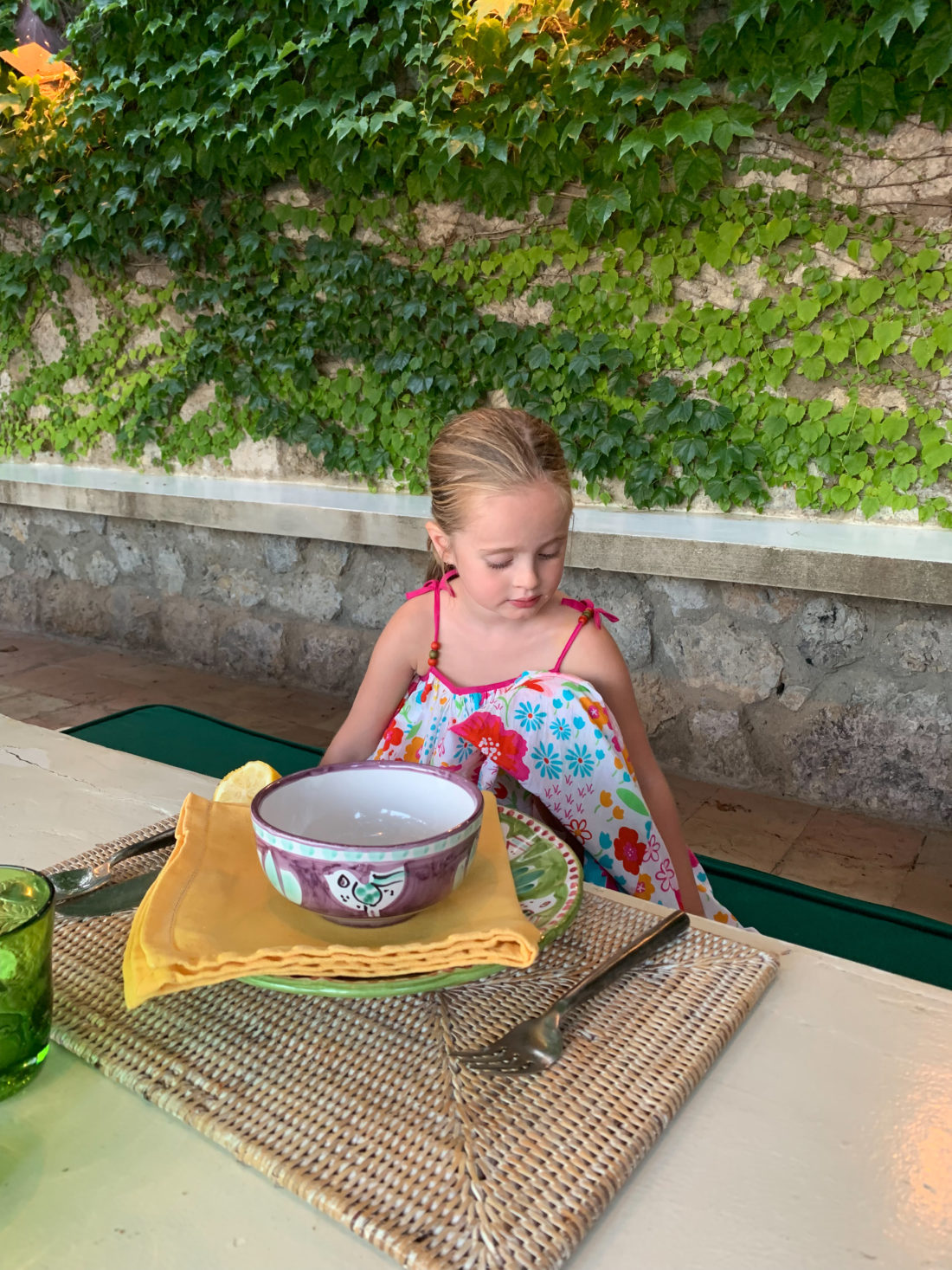 Marlowe Martino enjoying some lunch by the water in Italy