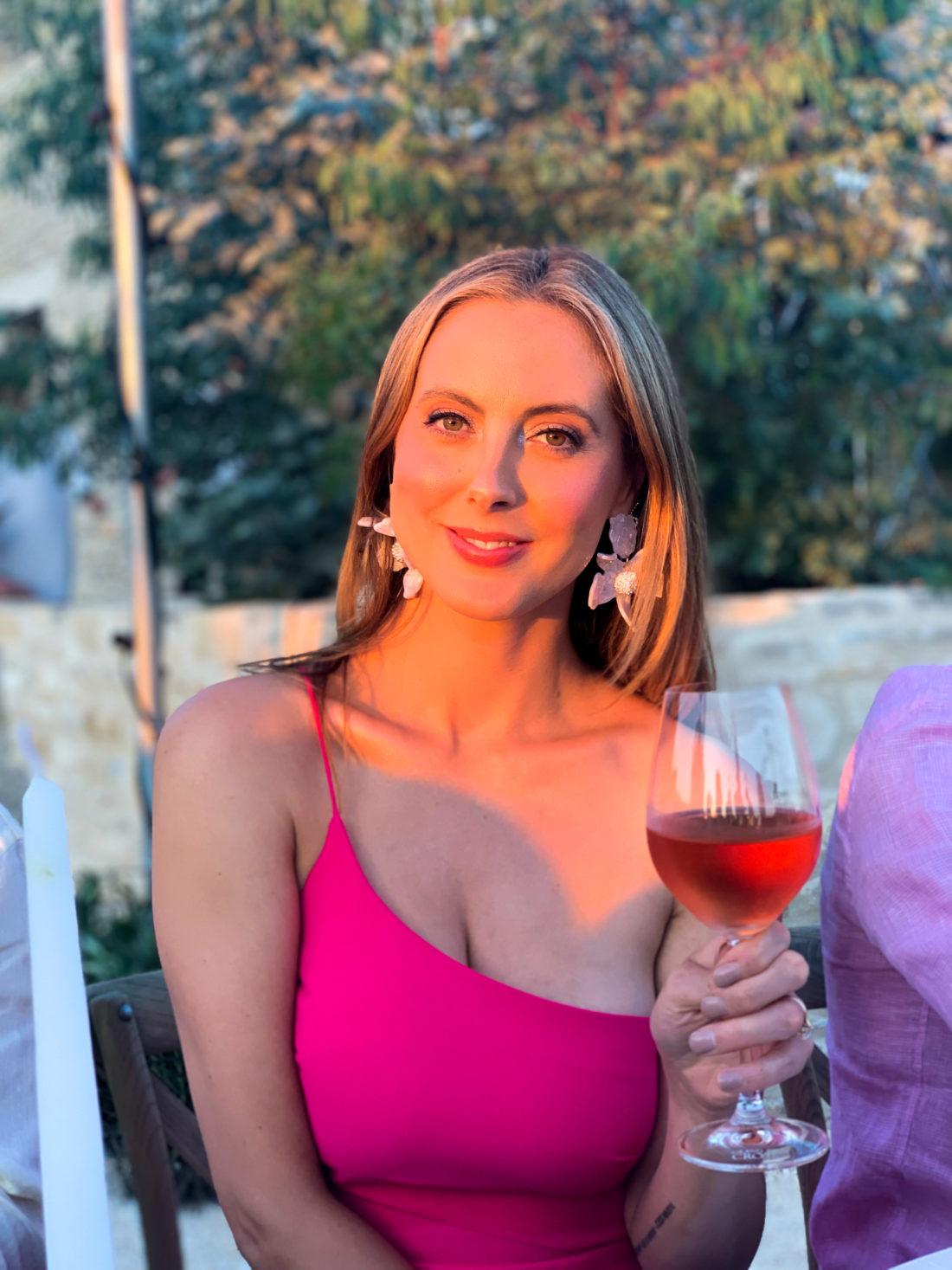 Eva Amurri Martino sips a glass of rosé at a wedding in Croatia