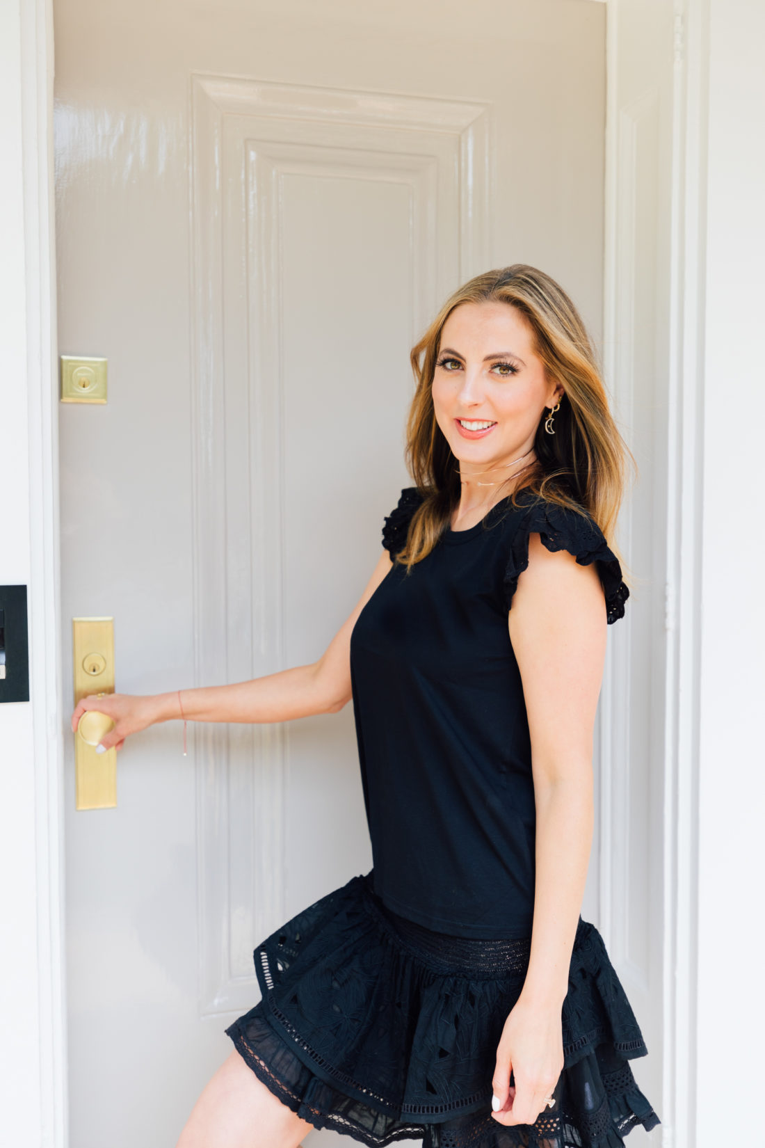 Eva Amurri Martino stands in the doorway of her newly renovated Connecticut home