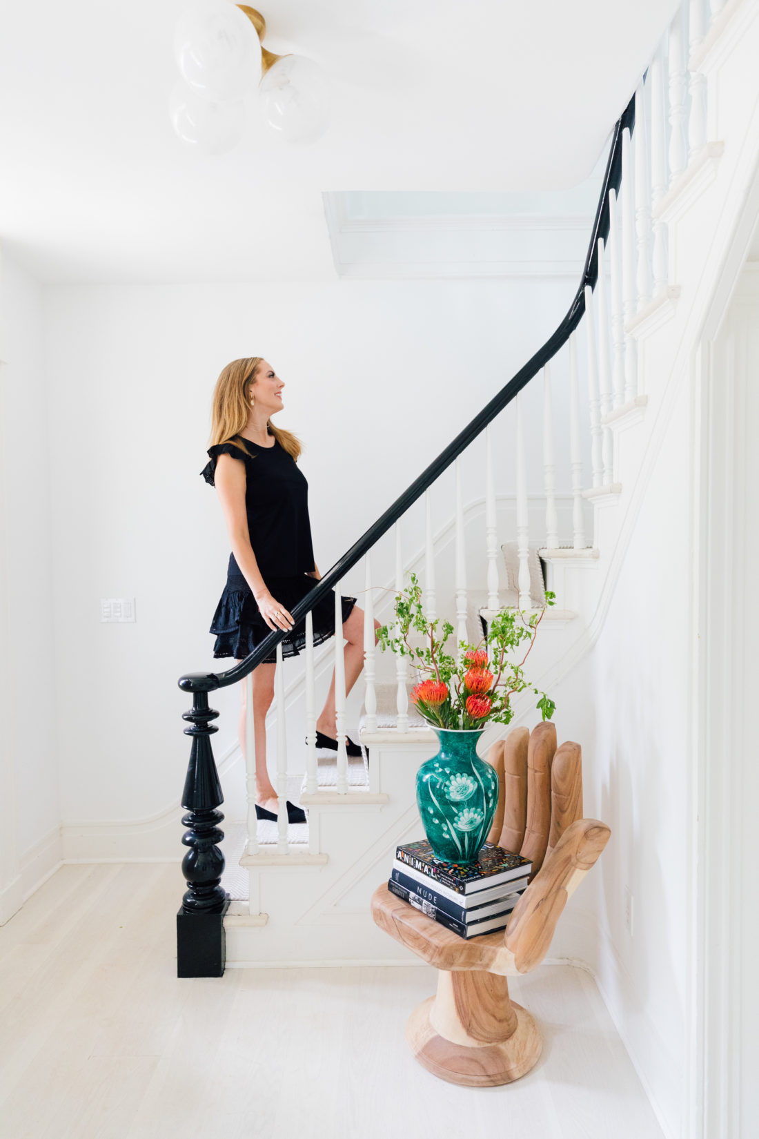 Eva Amurri Martino walks up the staircase of the entry way of her Connecticut home
