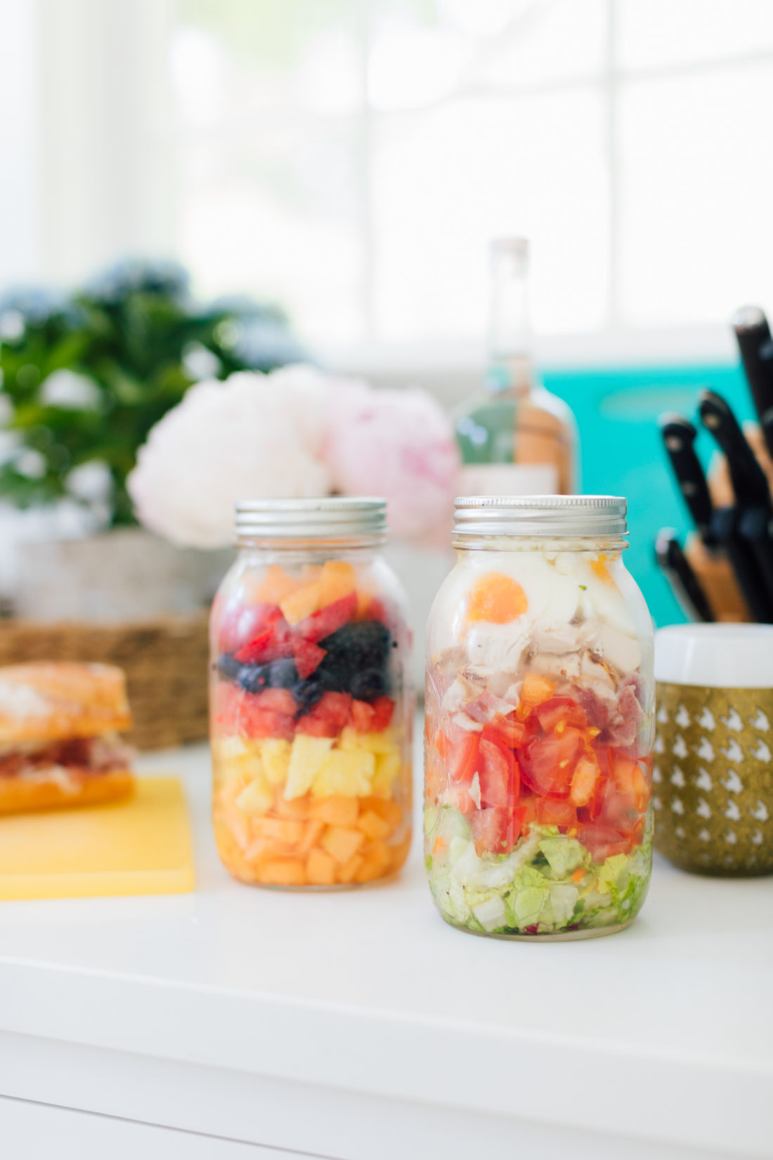 Eva Amurri Martino packs up fruit in mason jars for a picnic