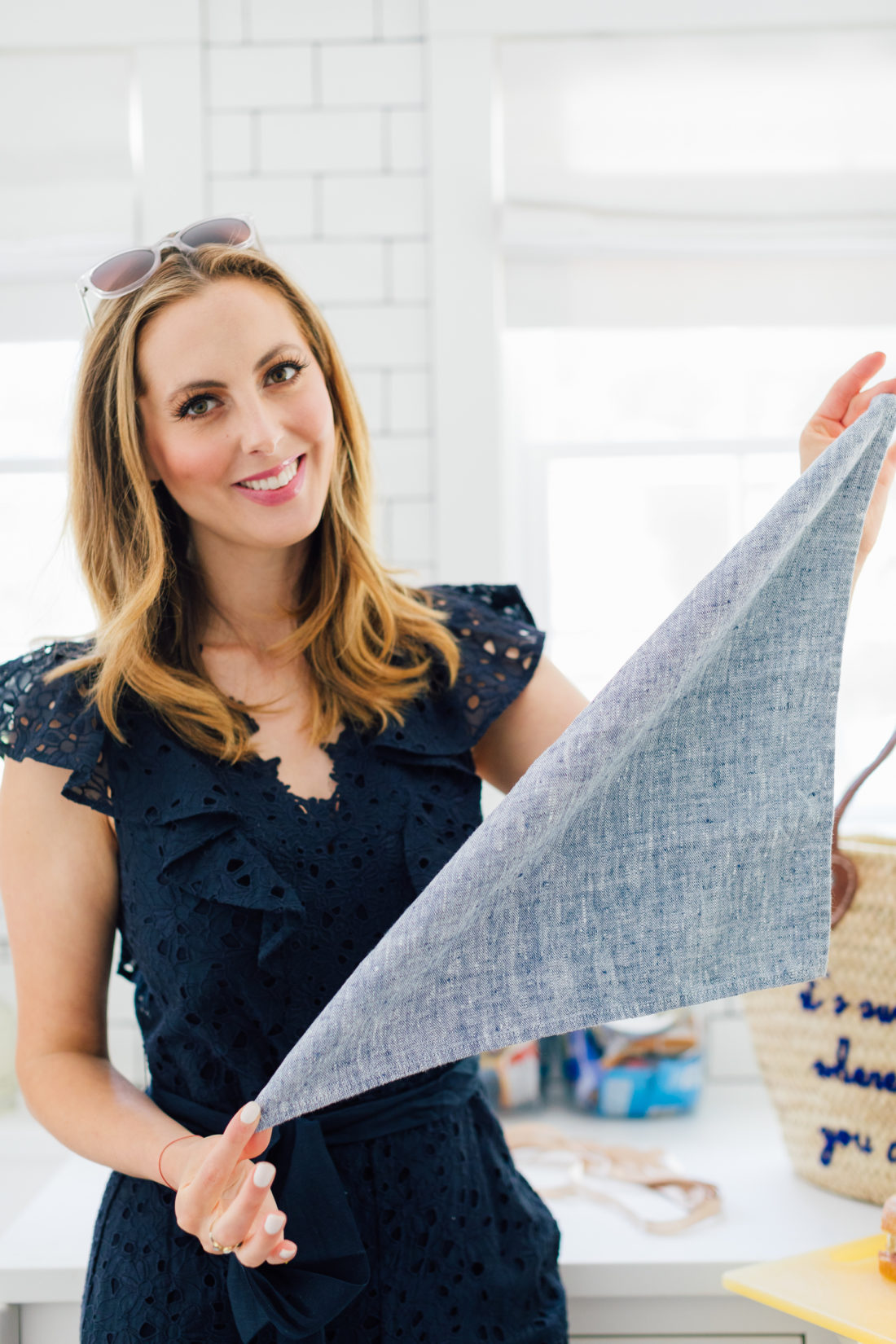 Eva Amurri Martino folds a napkin to wrap a sandwich for a picnic