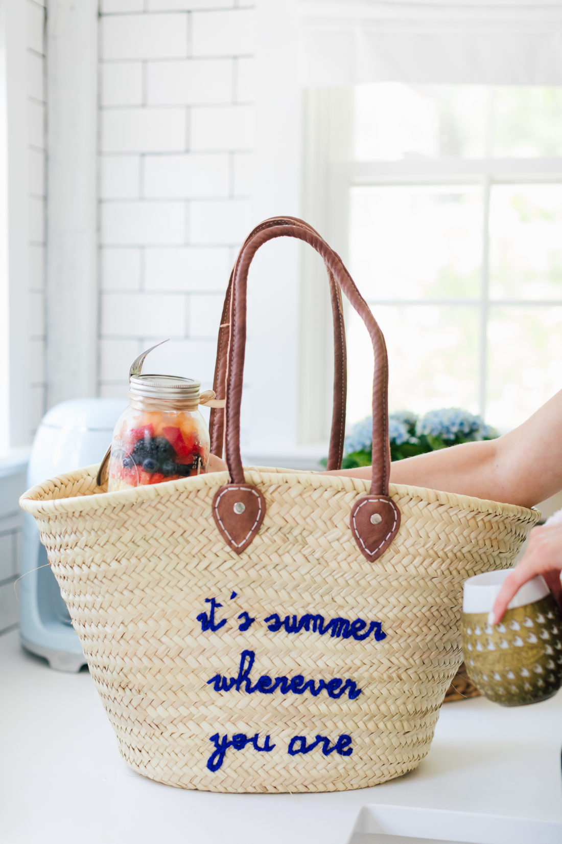 A straw bag that says It's Summer Whenever