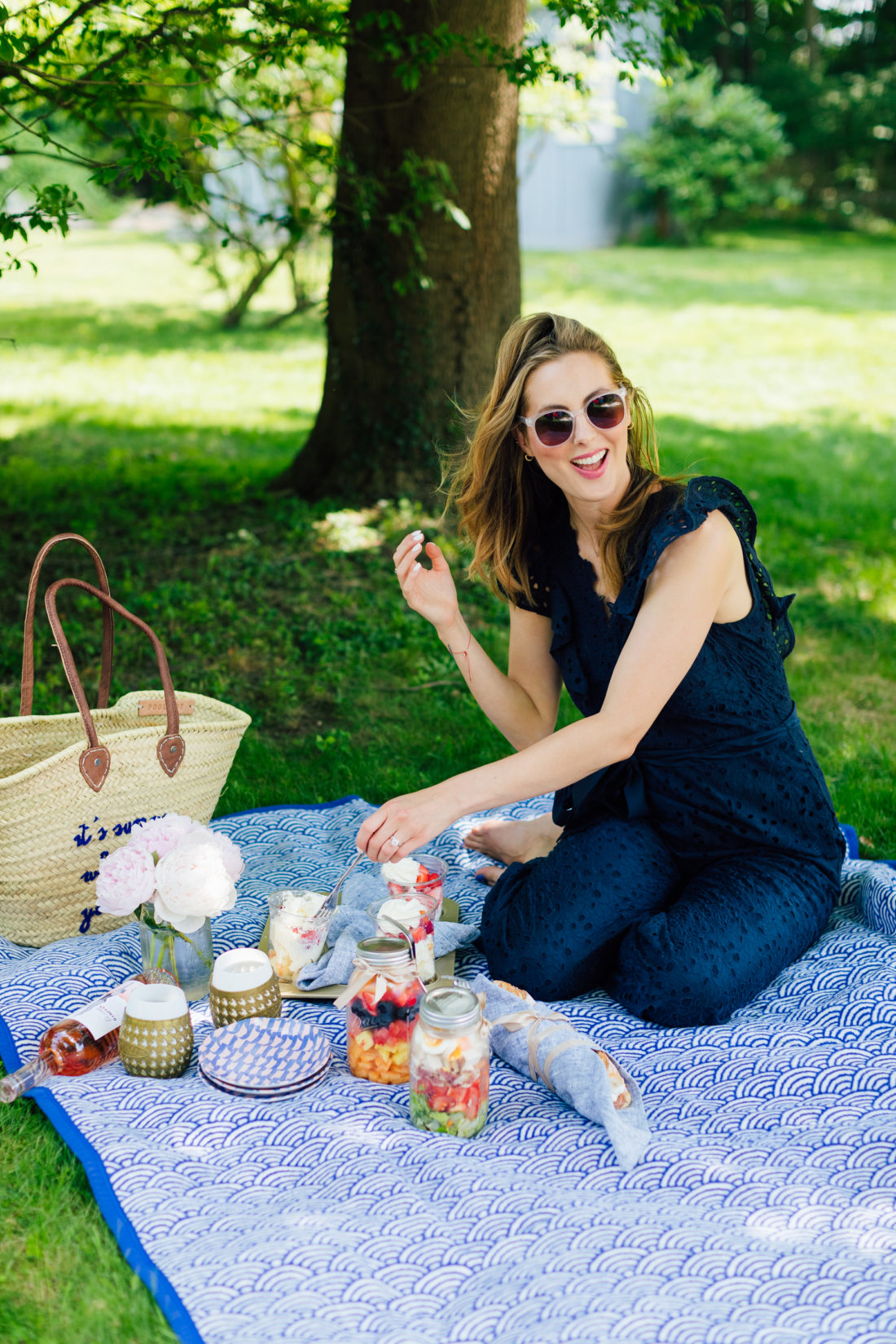 Eva Amurri Martino kneels on a picnic blanket in her backyard